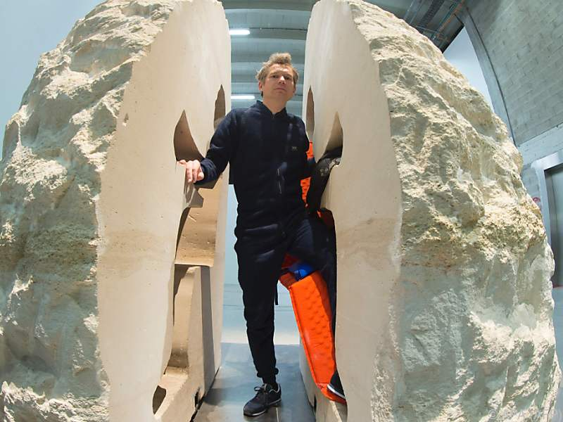 """French artist Abraham Poincheval performs """"Pierre"""" (Stone), at the Palais de Tokyo on February 22, 2017 in Paris..Poincheval was entombed on February 22, 2017 inside a 12-tonne boulder for a week, saying: """"I think I can take it."""" With the world's press looking on, the two halves of the limestone rock were closed on Abraham Poincheval by workmen in a Paris modern art museum.  / AFP PHOTO / JOEL SAGET / RESTRICTED TO EDITORIAL USE - MANDATORY MENTION OF THE ARTIST UPON PUBLICATION - TO ILLUSTRATE THE EVENT AS SPECIFIED IN THE CAPTION"""
